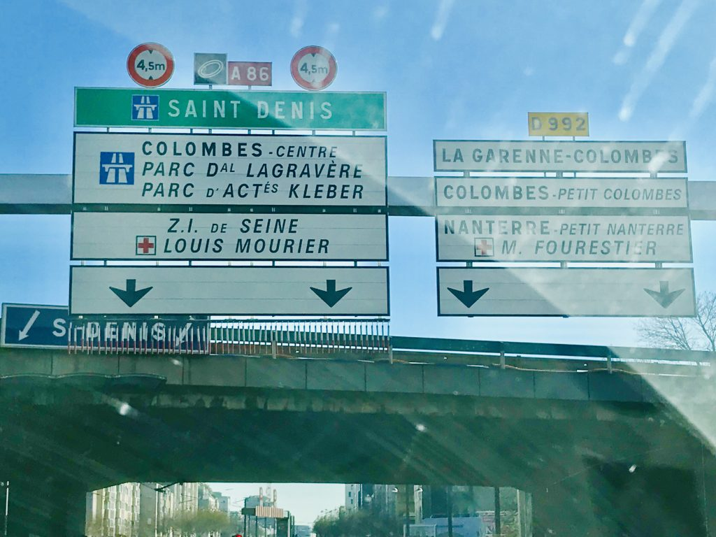 Road sign on a bridge in Greater Paris Area. Showing the sign to Saint Denis and the A86.