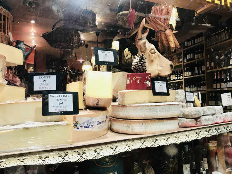 Window display of cheeses in France