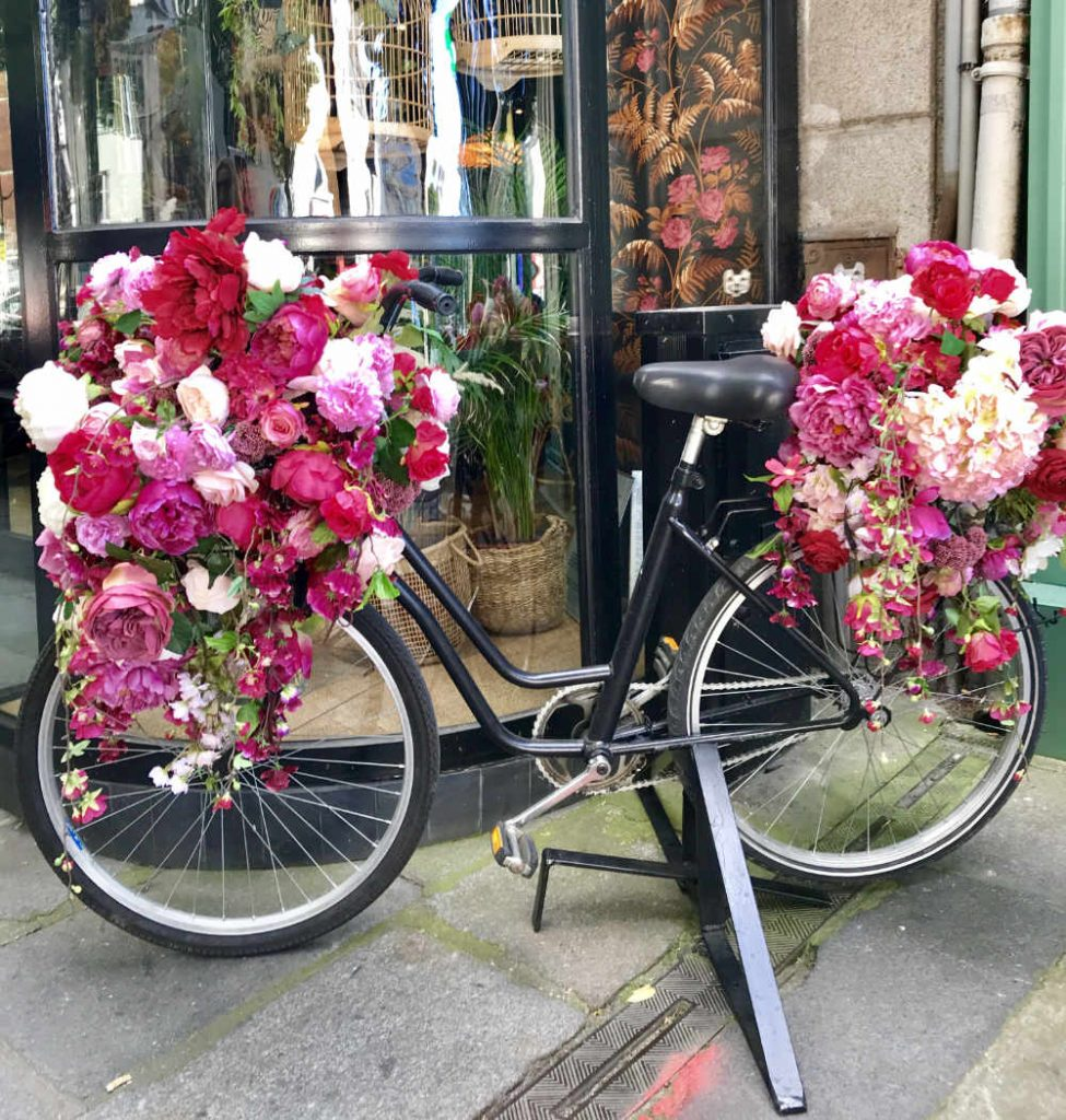 Bicycles with pink and flowers over it as decoration in France