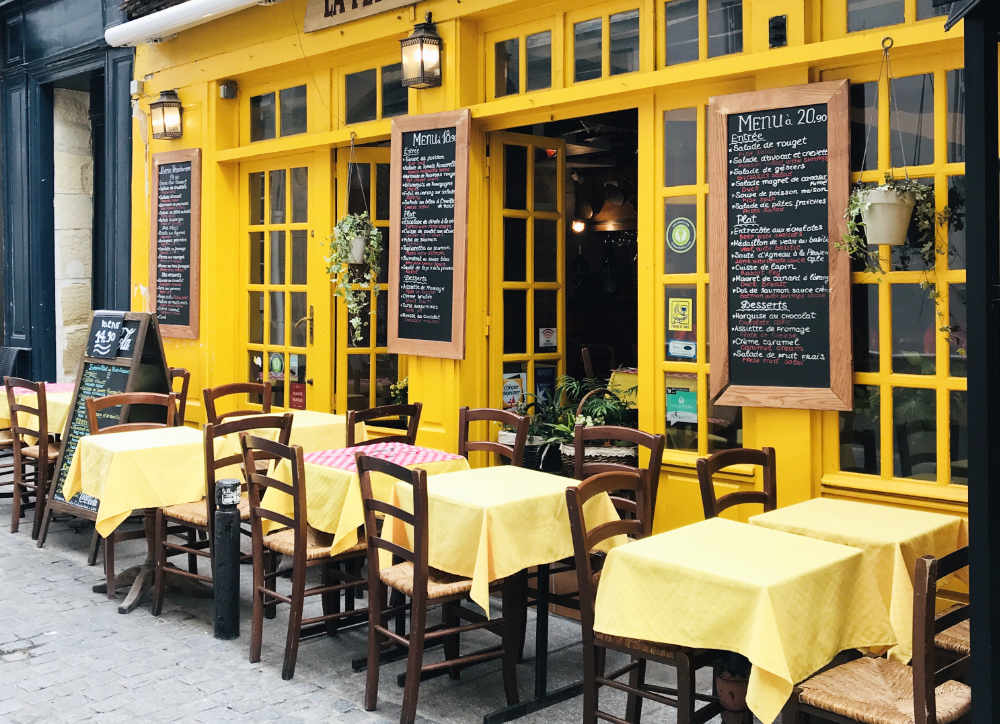 French Brasserie painted yellow, with a typical menu