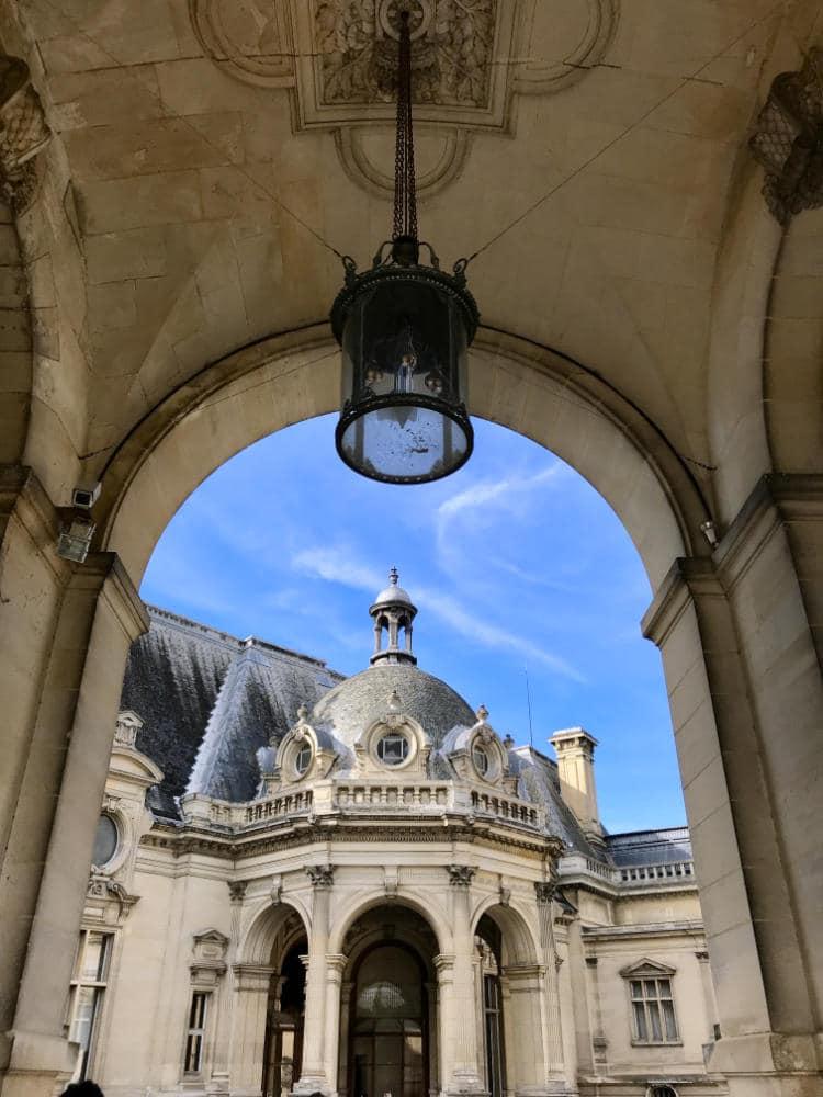 Château de Chantilly under the arch
