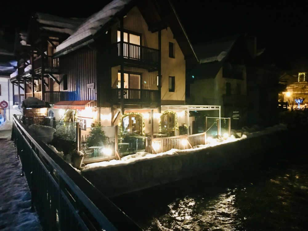 Serre Chevalier Restaurant on a stream at night-time