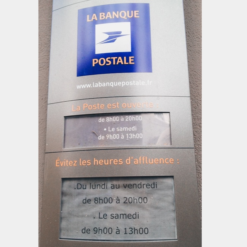 "Sign at French local post office, which says it is ""Open from 8am to 8pm. Avoid the busy hours from 8am to 8pm."""