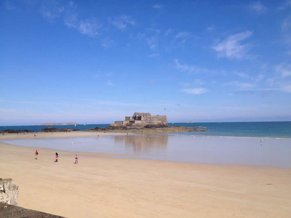 Beaches of Saint Malo at low tide with Fort National in the distance