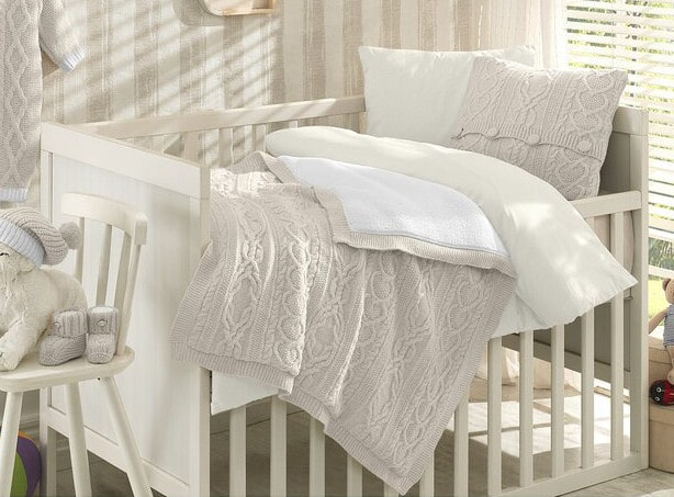 white luxury bedding for nursery