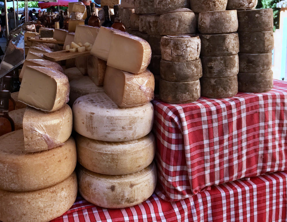 Cheese being sold in french farmers' market