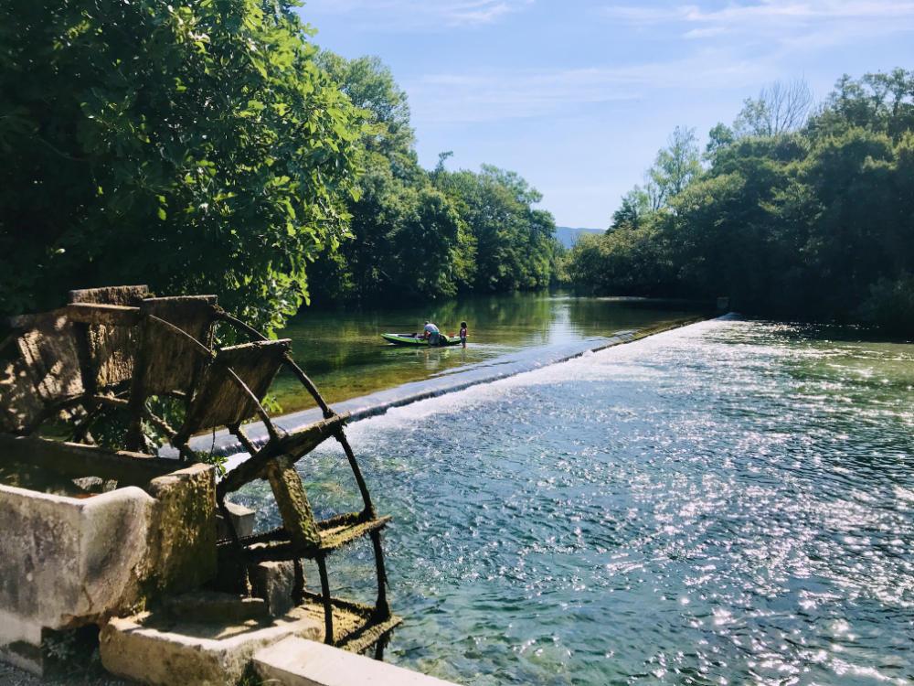 Watermill at the Partage des Eaux in Isle-sur-la-Sorgue