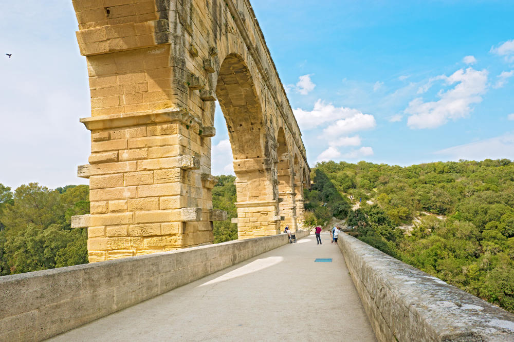 Walking along the bridge of Pont du Gard.