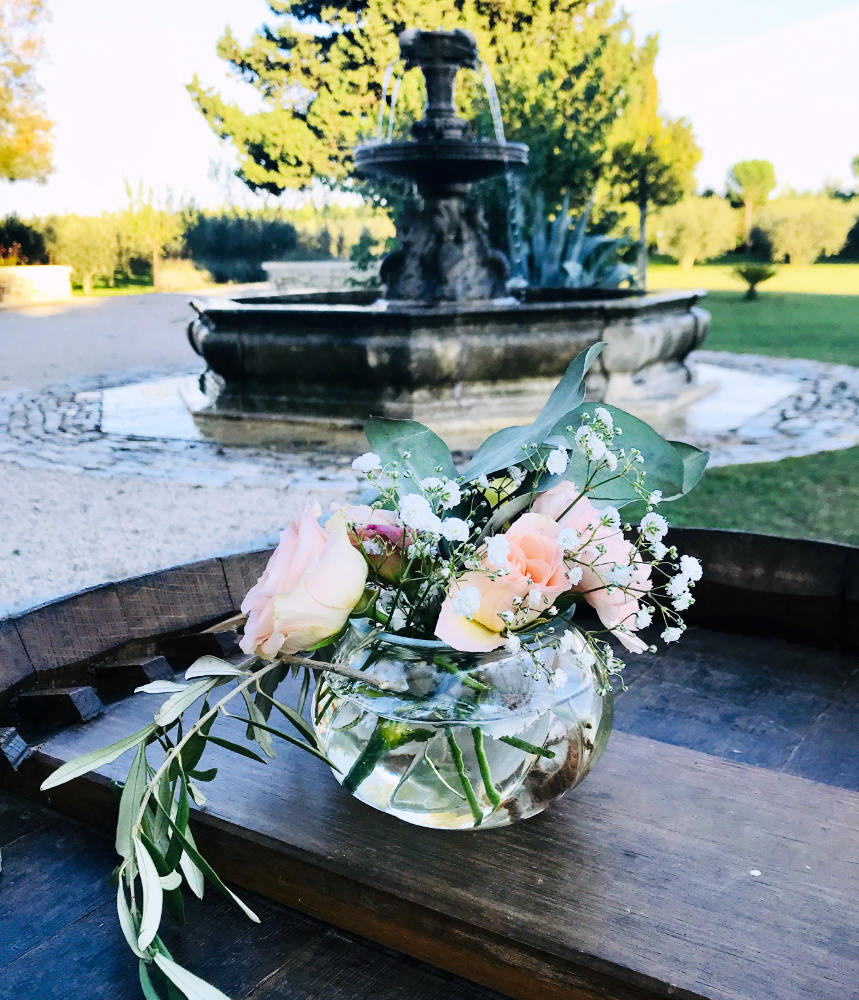 flowers for a wedding engagement with fountain in the background
