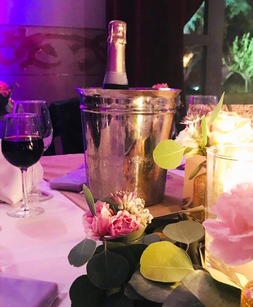 Champagne in a pail on a decorated table