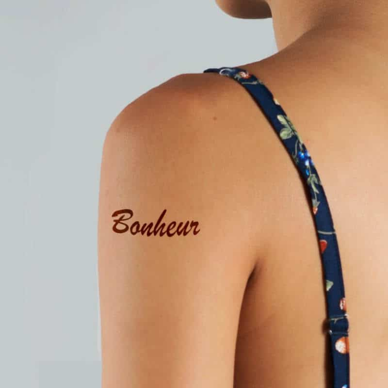 Bonheur - French word tattoo on upper arm