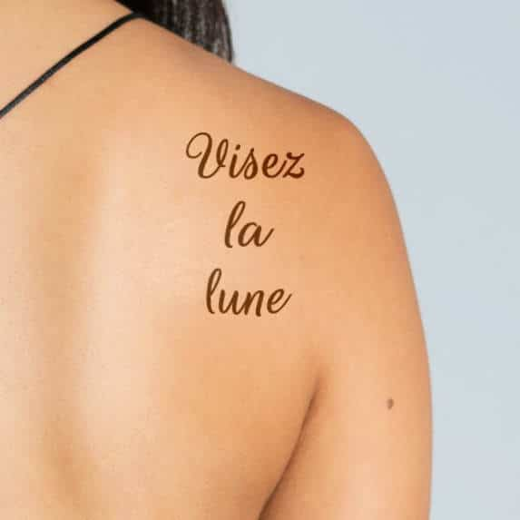 Visez la lune - French tattoo on the back