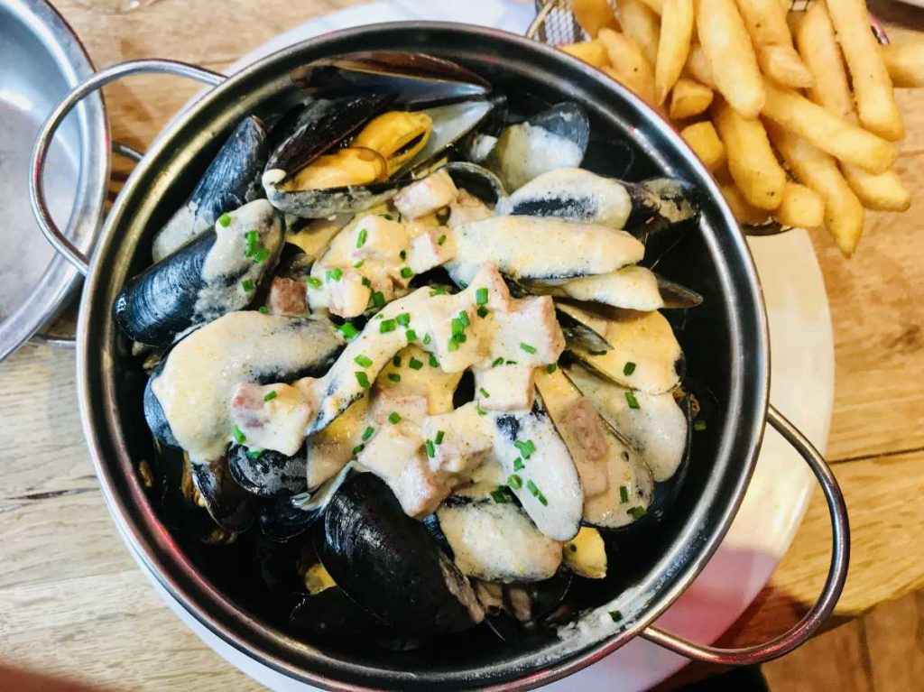 Moules frites in a dish