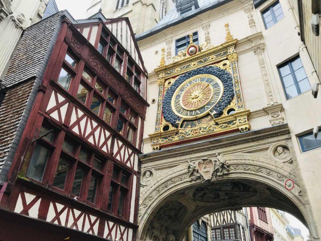Gros horloge in Rouen with head of angel turned upside down