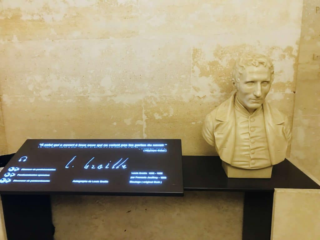 Statue of Louis Braille, with his signature