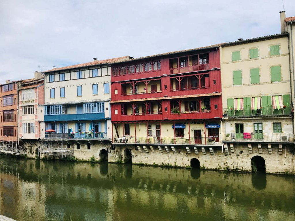 Colorful houses along the River Agout