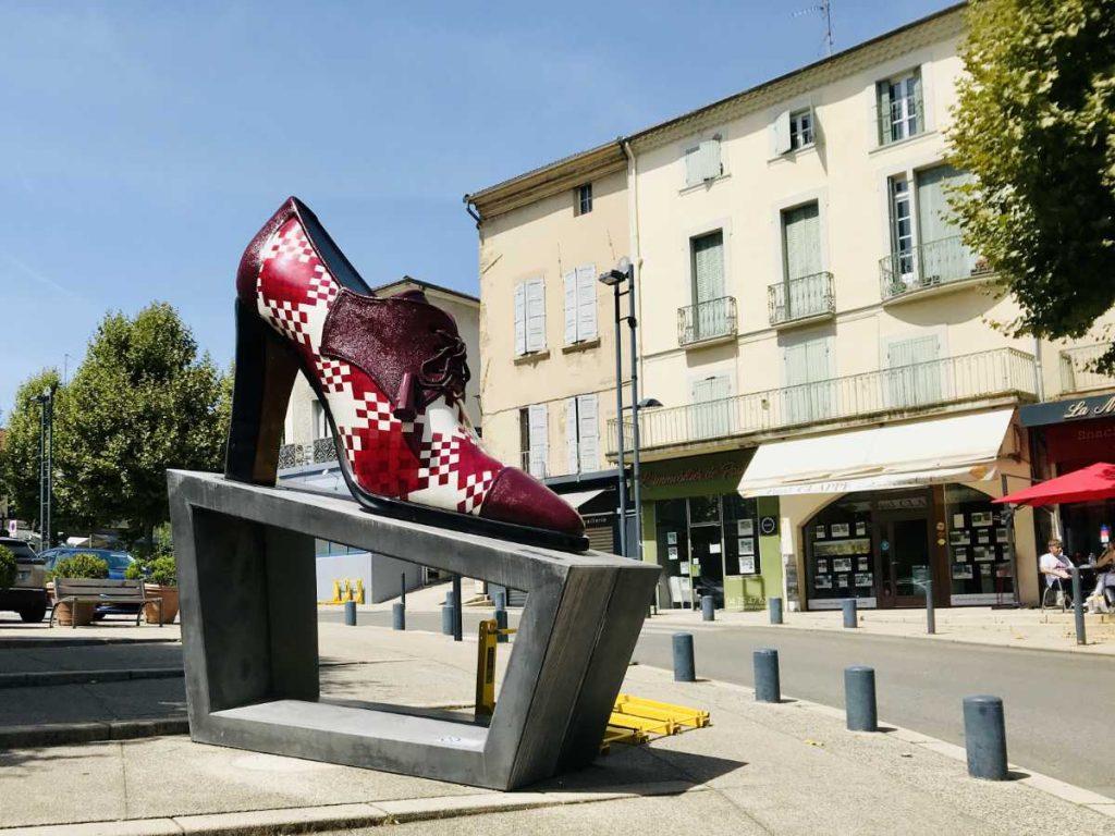 large red shoe monument in romans sur isere